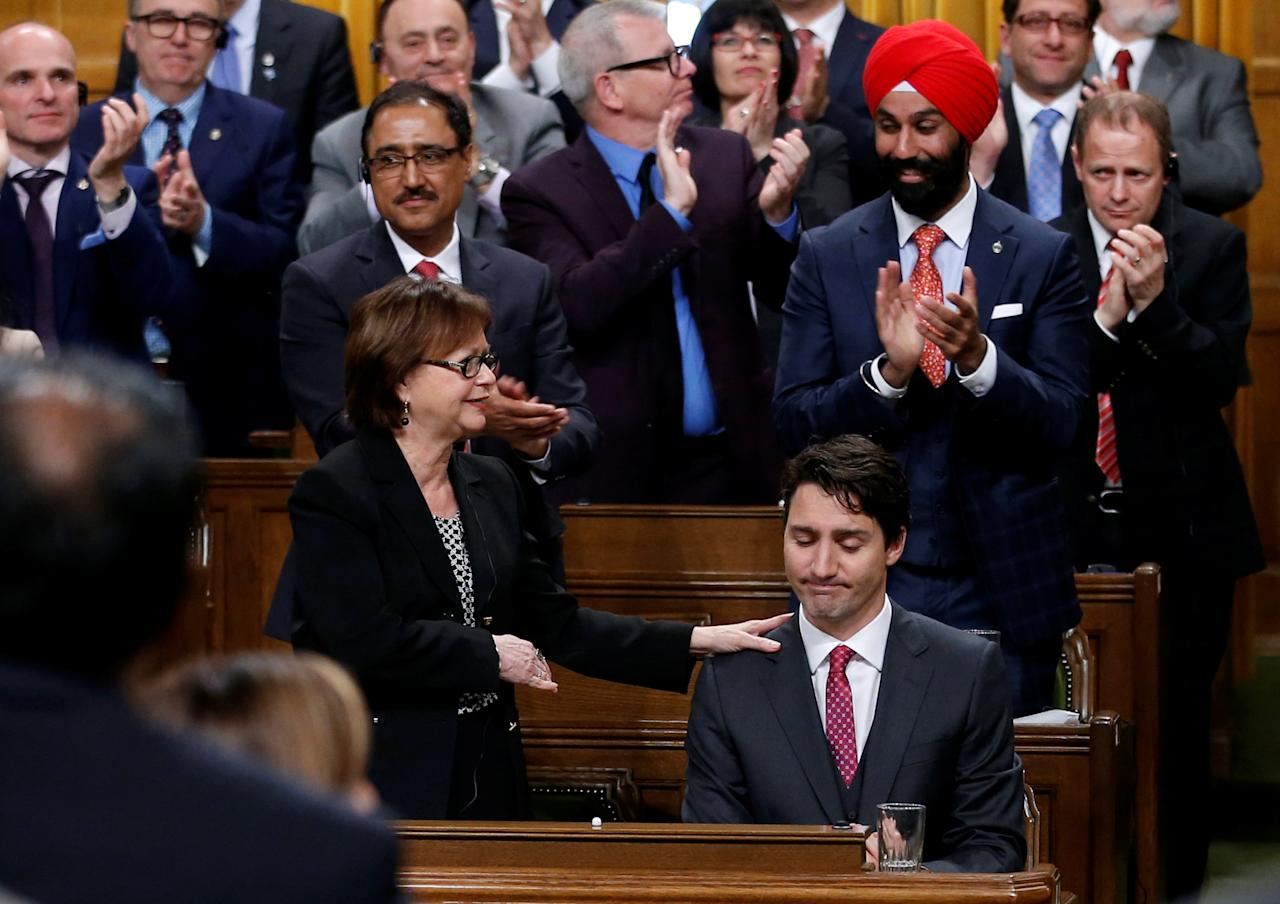 Canada's Prime Minister Justin Trudeau (seated) receives a standing ovation after delivering a formal apology for the Komagata Maru incident in the House of Commons on Parliament Hill in Ottawa, Canada, May 18, 2016. REUTERS/Chris Wattie     TPX IMAGES OF THE DAY