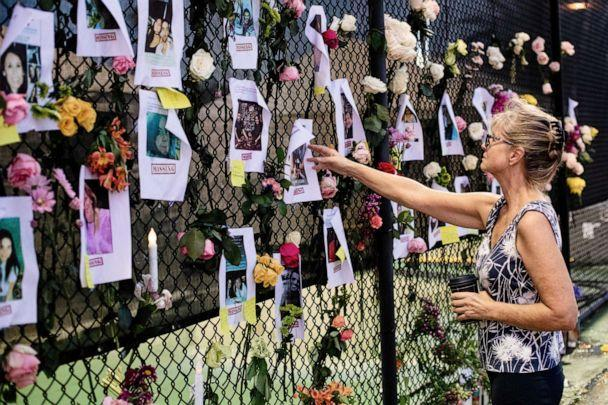 PHOTO: A woman looks at fliers of those thought missing in the collapse of the Champlain Towers South condominium complex in Surfside, Fla., June 26, 2021. (Scott McIntyre/The New York Times via Redux Pictures)