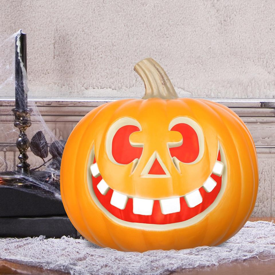 <p>This <span>Way to Celebrate Halloween Lighted Big Teeth Happy Face Blow Mold Pumpkin</span> ($7) is such a cute and friendly find. It's perfect for coffee tables, entrance consoles, and more.</p>
