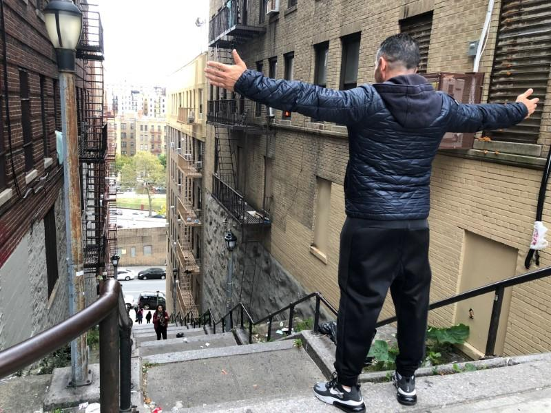 """Patricio Osuna, a tourist from Tijuana Mexico, poses atop the """"Joker steps"""" in the Bronx"""