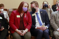 Kansas state Reps. Stephanie Byers, left, D-Wichita, and Brandon Woodard, D-Lenexa, confer during as a Senate committee considers a bill they oppose to ban transgender students from participating in girls' or women's school sports, Tuesday, March 16, 2021, at the Statehouse in Topeka, Kan. Byers is the first elected transgender state lawmaker in Kansas, and Woodard was one of the first two openly gay or lesbian lawmakers. (AP Photo/John Hanna)