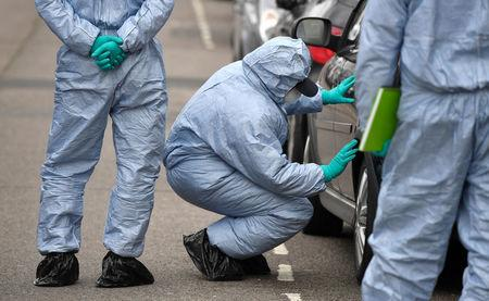 A forensic investigator examines a car on Chalgrove Road, where a teenage girl was murdered, in Tottenham, Britain, April 3, 2018. REUTERS/Toby Melville