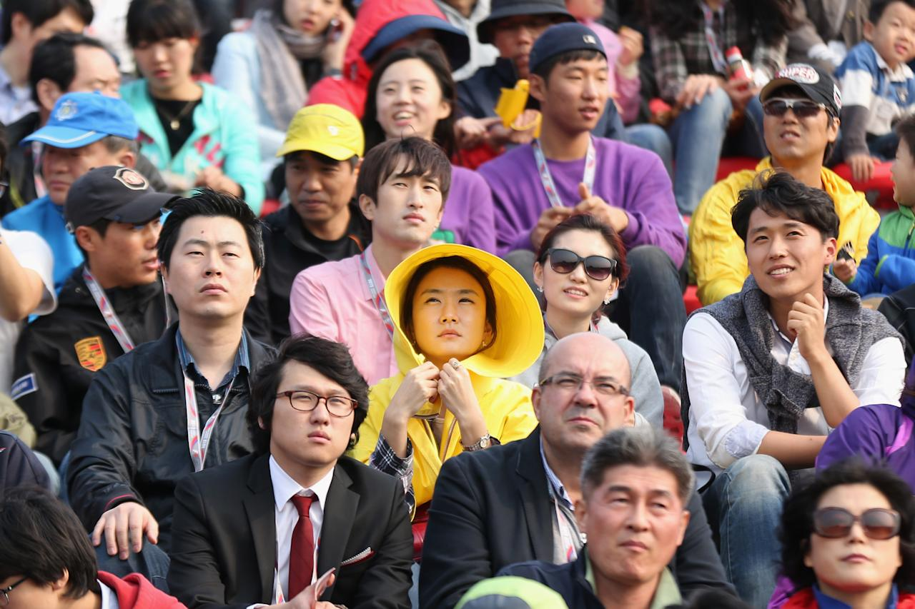 YEONGAM-GUN, SOUTH KOREA - OCTOBER 14:  Local fans are seen in the grandstand during the Korean Formula One Grand Prix at the Korea International Circuit on October 14, 2012 in Yeongam-gun, South Korea.  (Photo by Mark Thompson/Getty Images)