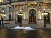 Left over ice dumped on the street in Glasgow in a protest by hospitality workers, as temporary restrictions announced by First Minister Nicola Sturgeon to help curb the spread of coronavirus have come into effect from 6pm, in Glasgow, Scotland, Friday, Oct. 9, 2020. (Douglas Barrie/PA via AP)