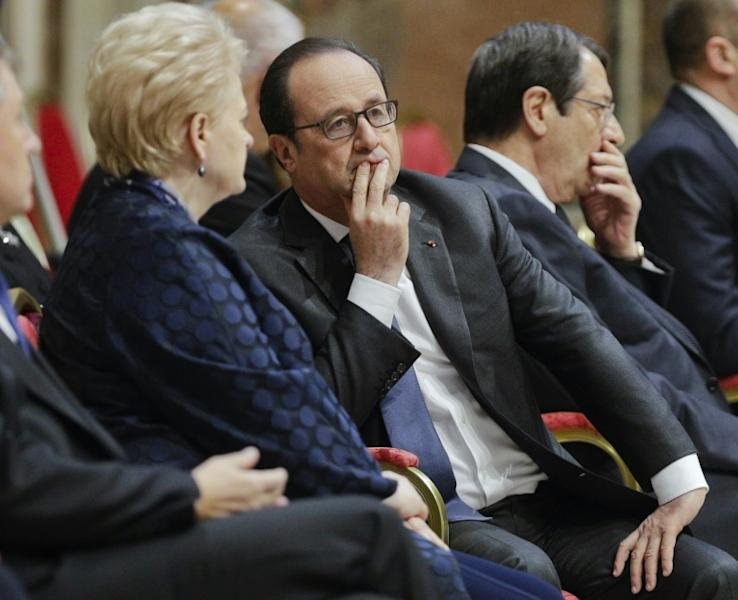France's President Francois Hollande (C) speaks to Lithuania's President Dalia Grybauskaite, as they wait for Pope Francis before an audience to European Union leaders at the Vatican, on March 24, 2017