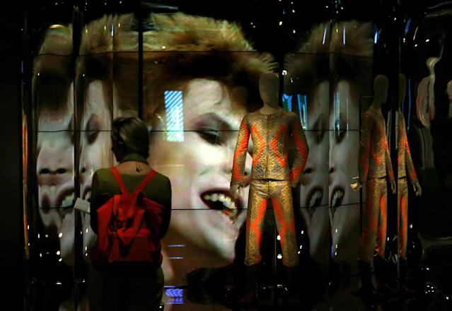 <p>A woman visits the new exhibition 'David Bowie Is' in Barcelona, Spain, May 24, 2017. The exhibition displays 300 objects related to the late British musician such as original costumes, photographs, music videos, instruments and albums. The exhibition will be open to public on 25 May at the Design Museum. (Photo: Toni Albir/EPA) </p>