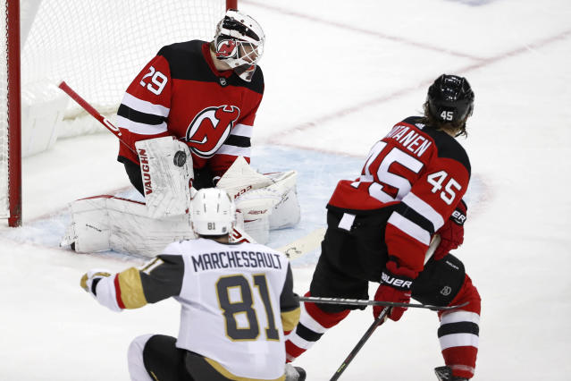 Vegas Golden Knights center Jonathan Marchessault (81) watches his shot on New Jersey Devils goaltender Mackenzie Blackwood (29) during the third period of an NHL hockey game, Tuesday, Dec. 3, 2019, in Newark, N.J. Marchessault scored three goals in the third period to help the Golden Knights defeat the Devils 4-3. New Jersey Devils defenseman Sami Vatanen (45) watches. (AP Photo/Kathy Willens)