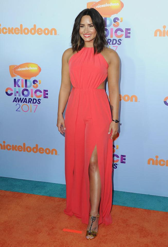 <p>The singer and actress was radiant in a hot-pink jumpsuit from Halston.(Photo: Getty Images) </p>