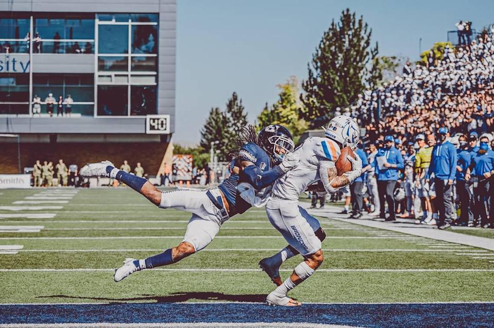 Boise State senior receiver Khalil Shakir scores on a 3-yard touchdown pass from Hank Bachmeier in the third quarter. The Broncos defeated Utah State 27-3 on Saturday in Logan, Utah.