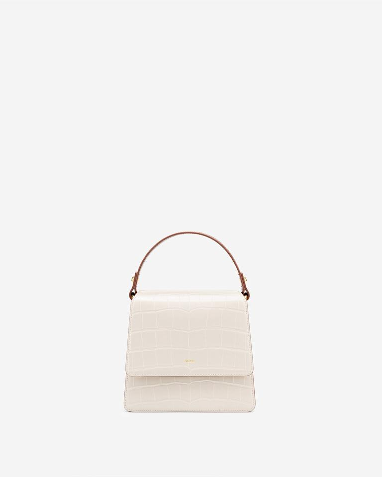 "49€ au lieu de 75€<br/><br/><a target=""_blank"" href=""https://www.jwpei.fr/collections/outlet/products/the-fae-top-handle-bag-beige-brown-croc "">Acheter</a>"