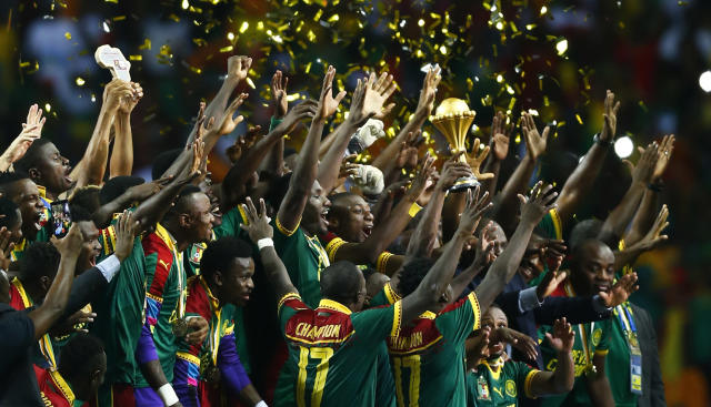 Football Soccer - African Cup of Nations - Final - Egypt v Cameroon - Stade d'Angondjé - Libreville, Gabon - 5/2/17 Cameroon celebrate with the trophy after winning the African Cup of Nations Reuters / Amr Abdallah Dalsh Livepic