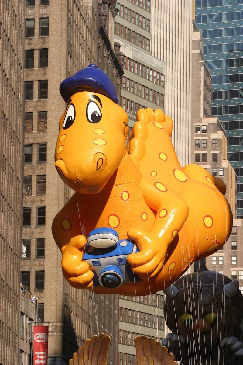 """This dino is solely responsible for kids of the 2000s asking their parents for a <a href=""""http://www.youtube.com/watch?v=SmGl2Qx1uDQ"""" target=""""_blank"""">cheese slip n' slide</a>."""
