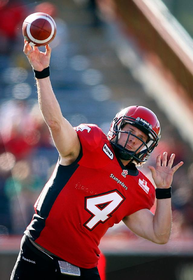 Calgary Stampeders' quarterback Drew Tate delivers a pass during first half CFL football action against the Montreal Alouettes in Calgary, Alta., Sunday, July 1, 2012. THE CANADIAN PRESS/Jeff McIntosh