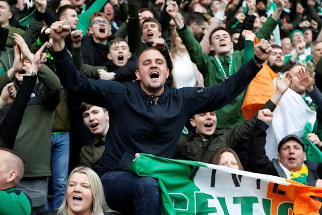 Soccer Football - Scottish Premiership - Rangers vs Celtic - Ibrox, Glasgow, Britain - March 11, 2018 Celtic fans celebrate REUTERS/Russell Cheyne