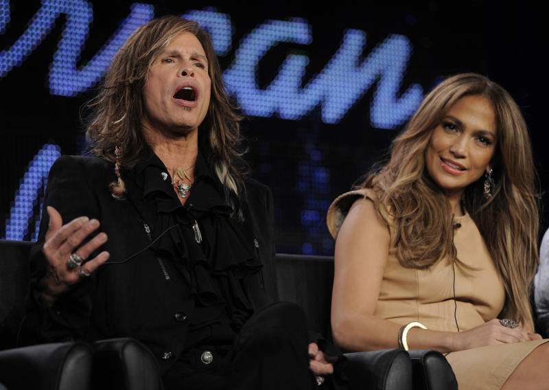 "Steven Tyler, left, and Jennifer Lopez, new judges on ""American Idol,"" take part in a panel discussion on the show during the FOX Broadcasting Company Television Critics Association winter press tour in Pasadena, Calif., Tuesday, Jan. 11, 2011. (AP Photo/Chris Pizzello)"
