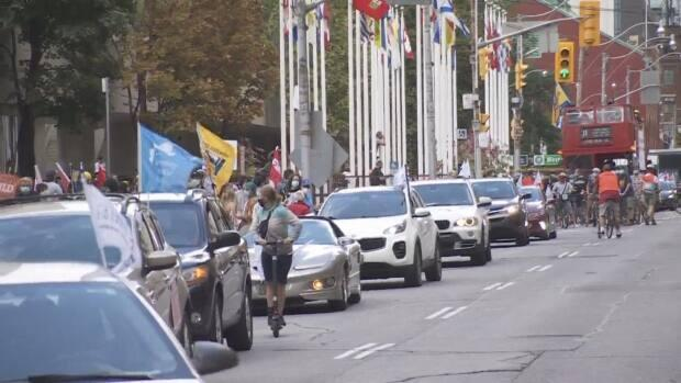 The Toronto and York Region Labour Council held a cavalcade parade from Nathan Phillips Square to Queen's Park on Labour Day in Toronto. (CBC - image credit)