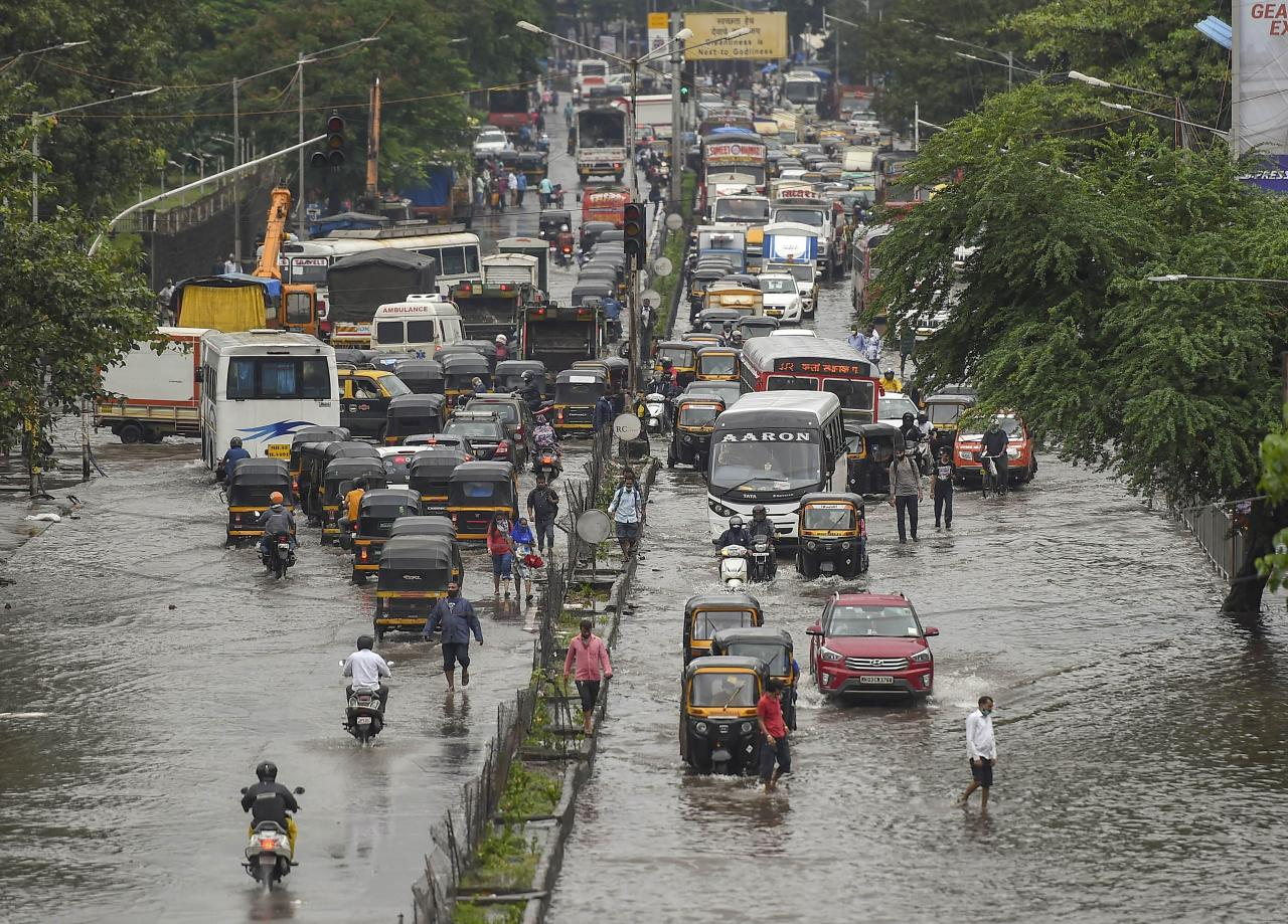Mumbai: Vehicles move on waterlogged LBS road after heavy monsoon rain, at Kurla in Mumbai, Wednesday, Sept. 23, 2020. (PTI Photo/Kunal Patil)(PTI23-09-2020_000073B)