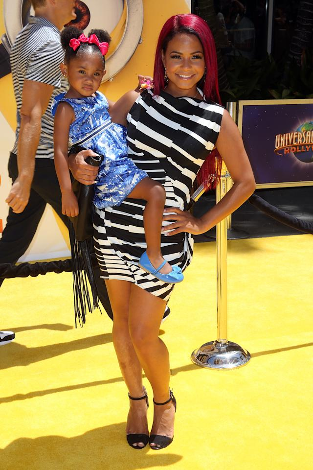"UNIVERSAL CITY, CA - JUNE 22: Actress Christina Milian (R) and her daughter attend the premiere of Universal Pictures' ""Despicable Me 2"" at the Gibson Amphitheatre on June 22, 2013 in Universal City, California. (Photo by Frederick M. Brown/Getty Images)"