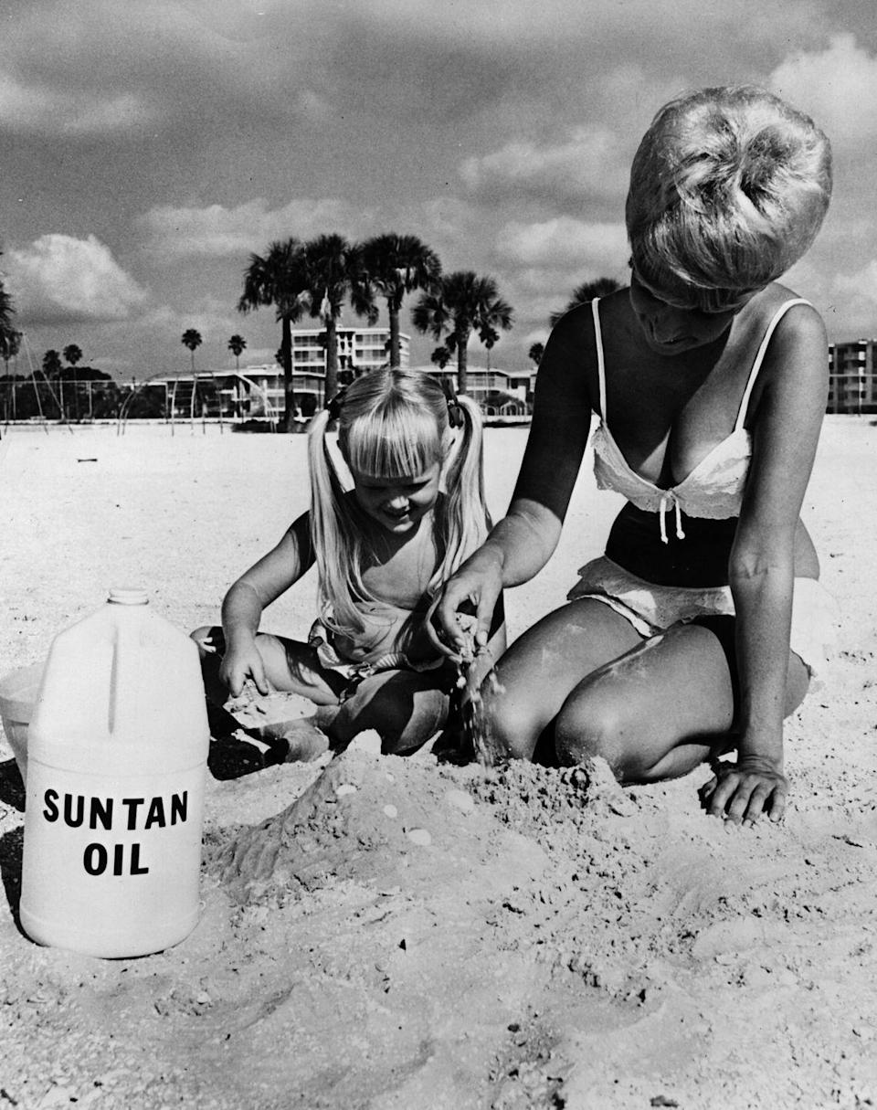 <p>The sandcastle is cool and all, but apparently people used to carry around <em>a literal jug</em> of suntan oil. </p>
