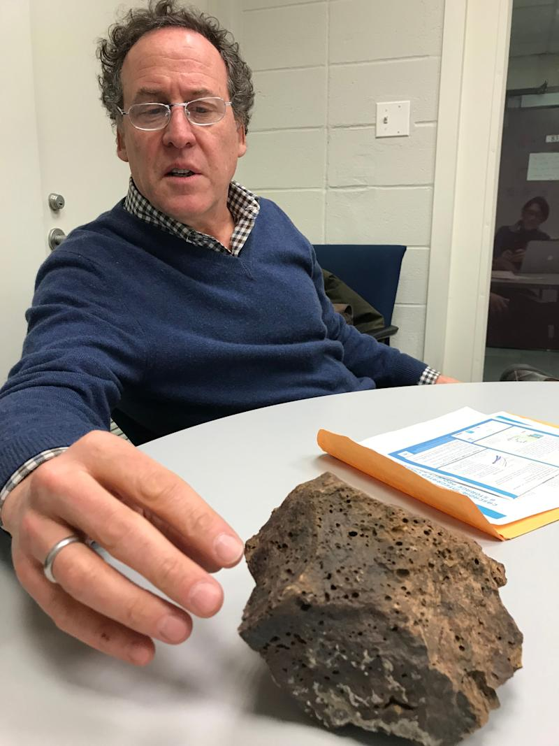 David Goldberg, a marine geology professor at Columbia's Lamont-Doherty Earth Observatory in Palisades, New York, with a piece of porous basalt from below the ocean floor off the coast in the Pacific Northwest. He's proposed a test that would pump 1 million tons of carbon dioxide 1,000 to 2,000 feet down. Iceland already has a similar pilot project up and running.