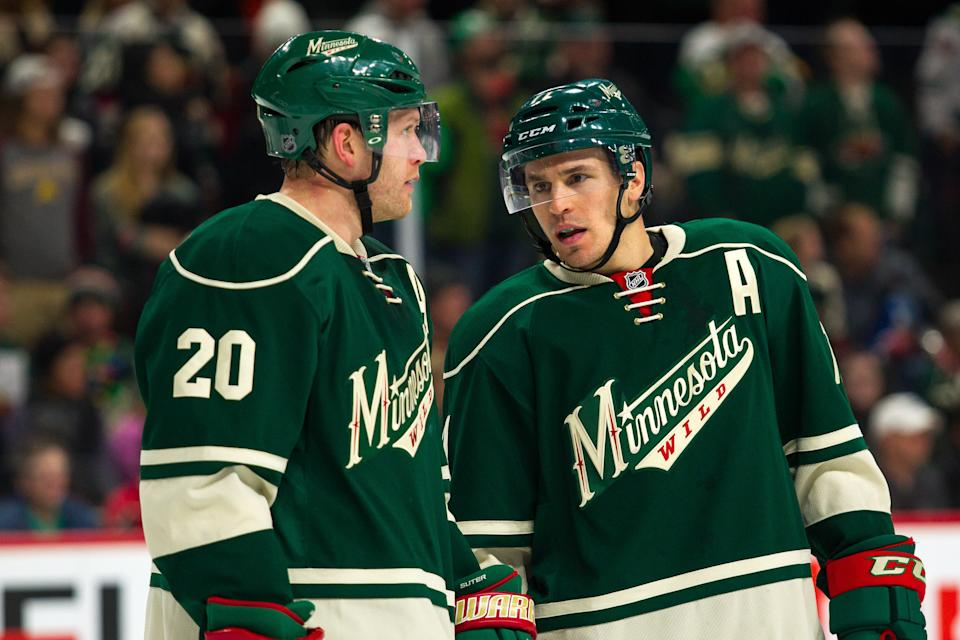 ST. PAUL, MN - DECEMBER 11: Ryan Suter #20 and Zach Parise #11 of the Minnesota Wild before the faceoff during the Central Division match up between the St. Louis Blues and the Minnesota Wild on December 11, 2016, at Xcel Energy Center in St. Paul, Minnesota. The Wild won 3-1. (Photo by David Berding/Icon Sportswire via Getty Images)