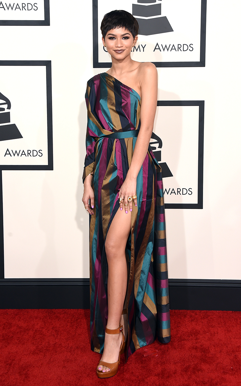 """<p>I had to do a double-take when Zendaya arrived at the <a href=""""https://www.cosmopolitan.com/uk/fashion/celebrity/news/g3953/grammys-2015-celebrities-red-carpet-fashion-photos"""" rel=""""nofollow noopener"""" target=""""_blank"""" data-ylk=""""slk:2015 Grammys"""" class=""""link rapid-noclick-resp"""">2015 Grammys</a> with this pixie cut and another fab <a href=""""https://www.cosmopolitan.com/uk/fashion/celebrity/news/g3953/grammys-2015-celebrities-red-carpet-fashion-photos/?slide=16"""" rel=""""nofollow noopener"""" target=""""_blank"""" data-ylk=""""slk:Vivienne Westwood dress"""" class=""""link rapid-noclick-resp"""">Vivienne Westwood dress</a>, this time featuring jewel-toned stripes.</p>"""
