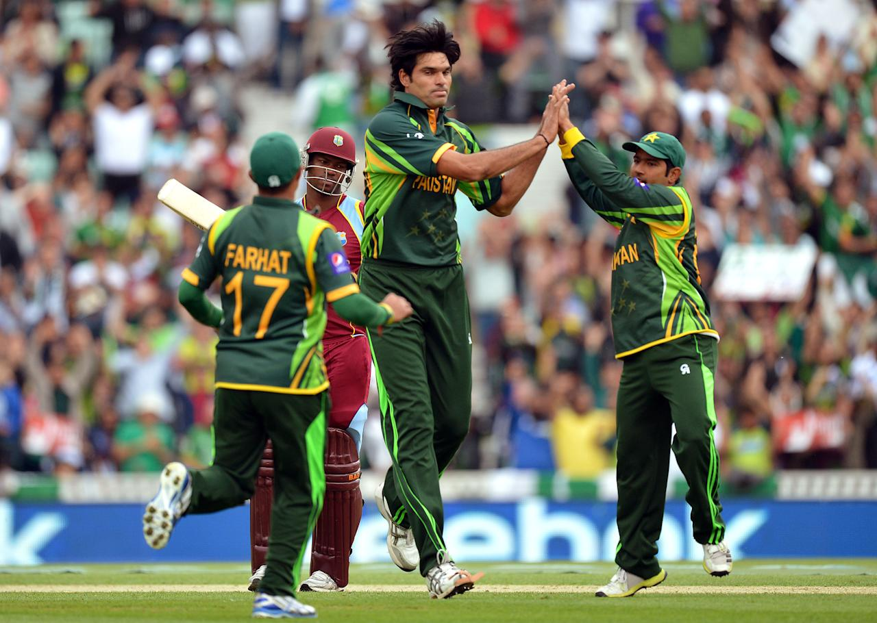 Pakistan's Mohammad Irfan (centre) celebrates taking the wicket of West Indies' Johnson Charles (second left) during the ICC Champions Trophy match at The Oval, London.