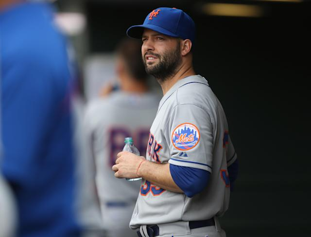 New York Mets starting pitcher Dillon Gee looks on from the dugout after he was pulled against the Colorado Rockies in the seventh inning of the Mets' 5-1 victory in a baseball game in Denver, Sunday, May 4, 2014. (AP Photo/David Zalubowski)