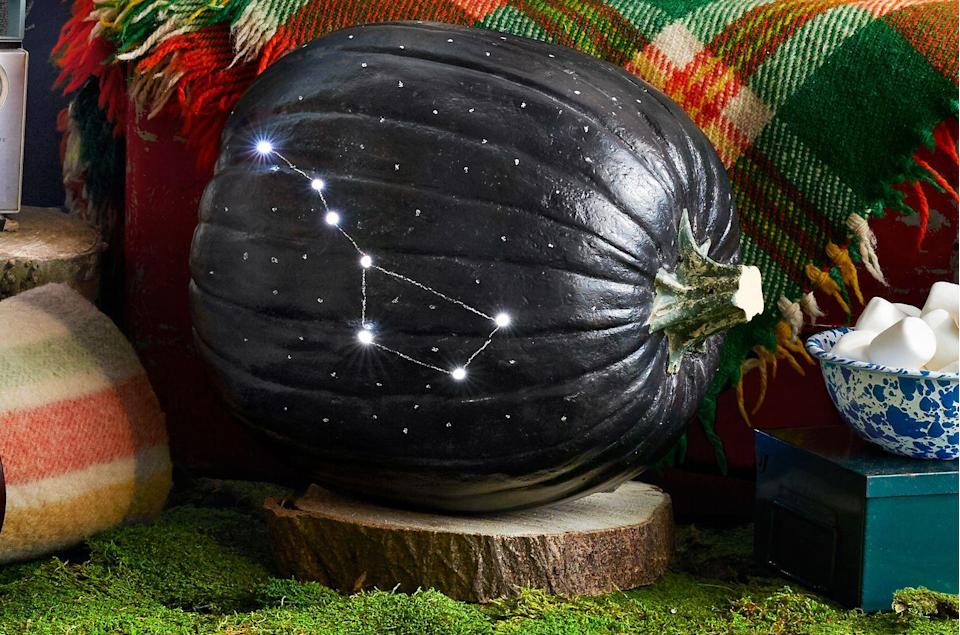 "<p>A twinkling twist on typical carved decor. Cut a hole in the back of a large pumpkin and scoop out pulp and seeds. Coat the surface with <a href=""https://www.amazon.com/dp/B01DJ416NS?tag=syn-yahoo-20&ascsubtag=%5Bartid%7C10050.g.1350%5Bsrc%7Cyahoo-us"" rel=""nofollow noopener"" target=""_blank"" data-ylk=""slk:chalkboard spray-paint"" class=""link rapid-noclick-resp"">chalkboard spray-paint</a> and let dry; season as instructed. Use white stick chalk to mark the Big Dipper, then drill through the points with a medium drill bit. Insert a <a href=""https://www.amazon.com/GardenDecor-Decorative-Battery-Powered-Bedroom/dp/B071CFJ52T?tag=syn-yahoo-20&ascsubtag=%5Bartid%7C10050.g.1350%5Bsrc%7Cyahoo-us"" rel=""nofollow noopener"" target=""_blank"" data-ylk=""slk:battery-powered string of lights"" class=""link rapid-noclick-resp"">battery-powered string of lights</a> in the constellation points. Use white chalk to connect points, and draw additional stars on pumpkin.</p>"