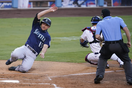 Seattle Mariners' Kyle Seager scores on a single from Austin Nola during the first inning of a baseball game against the Los Angeles Dodgers Monday, Aug. 17, 2020, in Los Angeles. (AP Photo/Marcio Jose Sanchez)
