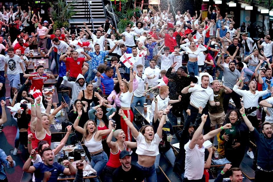 Fans watching England v Denmark (PA Wire)