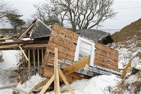 A 200-year-old beach house lies in ruin after being blown off its foundation in Chatham