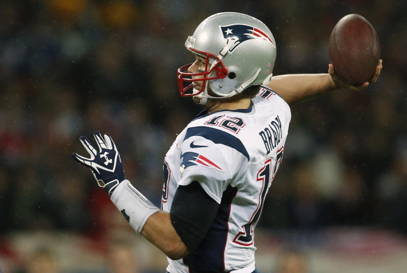New England Patriots quarterback Tom Brady, in action during the first half of a NFL football game at Wembley Stadium, London, Sunday, Oct. 28, 2012. (AP Photo/Matt Dunham)
