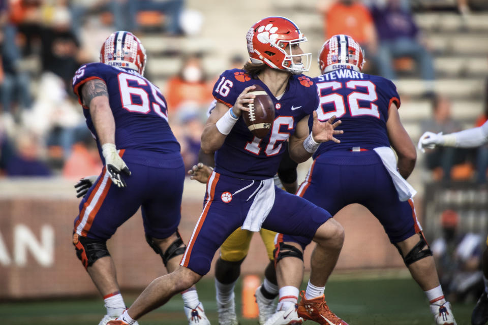 Clemson quarterback Trevor Lawrence (16) looks to make a pass during the first half of an NCAA college football game against Pittsburgh Saturday, Nov. 28, 2020, in Clemson, S.C. (Ken Ruinard/The Independent-Mail via AP, Pool)