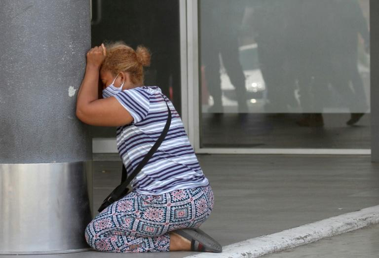 A woman cries after learning of the death of a relative at Los Ceibos Hospital in Guayaquil, the city hardest hit by COVID-19 epidemic in Ecuador