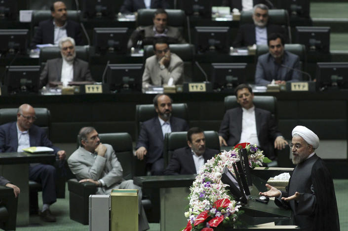 In this Sunday, July 14, 2013 photo released by the official website of the office of Iranian President-elect Hasan Rouhani, Rouhani, bottom right, speeches in a meeting with lawmakers at the parliament, in Tehran, Iran. The Iranian president's inner circle brings more than new names to the Islamic Republic's power structures _ the group of advisers and allies also carries an array of degrees from Western universities. Few doubt that Hasan Rouhani will bring a far calmer and more measured approach than his predecessor. What remains unclear is how much it could actually influence Iranian policies. (AP Photo/Office of the President-elect, Mohammad Berno)