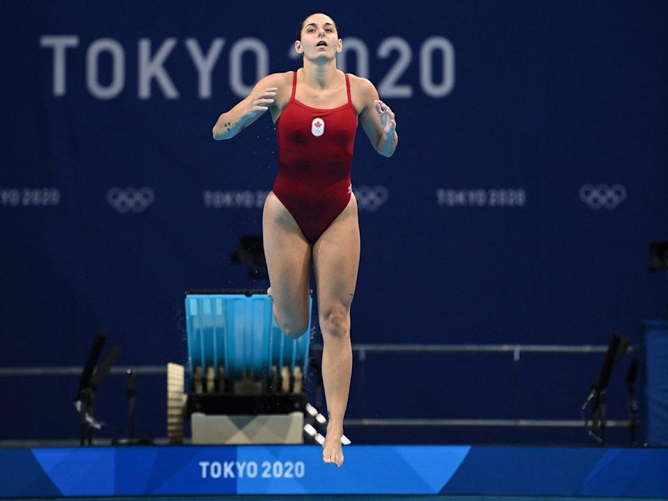 Pamela Ware slips on the diving board at the Olympics.