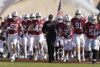 FILE - In this Nov. 23, 2019, file photo, Stanford head coach David Shaw, center, leads his team onto the field before an NCAA college football game against California in Stanford, Calif. Shaw could look at it as Stanford and the Pac-12 are behind the rest of the country with a late start to the football season, which will end up being a seven-game, all-conference schedule if all goes as planned. (AP Photo/Tony Avelar, File)