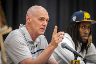 """FILE - Indiana Pacers head coach Rick Carlisle, left, responds to questions by the media during an NBA basketball news conference in Indianapolis, in this Friday, July 30, 2021, file photo. Pacers coach Rick Carlisle says his new team has a """"very high"""" vaccination rate but declined to give a specific number because of privacy concerns. He did say Monday during NBA media day that all members of the Indiana coaching staff are fully vaccinated. Carlisle is back in Indiana, where he coached from 2003 through 2007. Training camps open Tuesday and the pandemic will affect a third NBA season and already means some players will be missing on media day.(Doug McSchooler/The Indianapolis Star via AP, File)"""