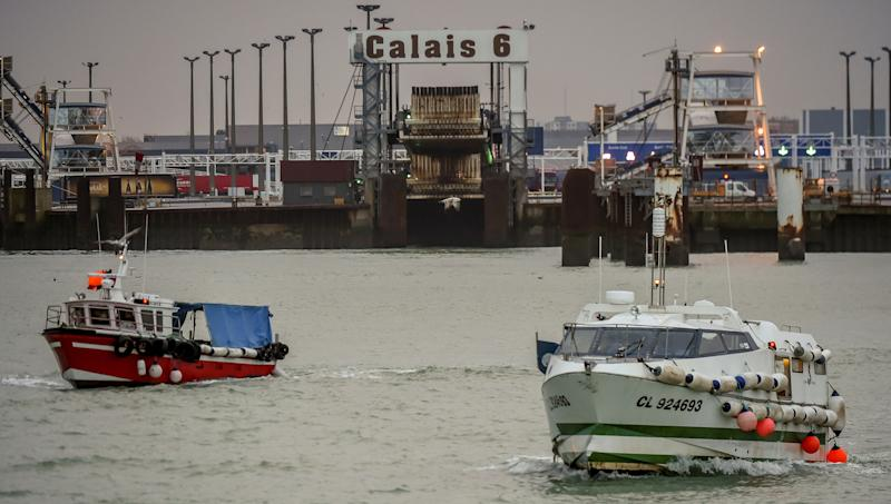 Fishing boats leave the harbour of Calais on January 25, 2018 to take part in a blockade to protest against electric pulse fishing practiced by fishermen from Netherlands. French fishermen blocked the port of Calais, preventing cross-Channel ferries arriving or departing, and a road leading to the port of Boulogne-sur-Mer, about 30 kilometres (20 miles) southwest of Calais, to demand a ban on electric pulse fishing in the North Sea. Pulse fishing involves dragging electrically-charged lines just above the seafloor that shock marine life up from low-lying positions into trawling nets. / AFP PHOTO / Philippe HUGUEN (Photo credit should read PHILIPPE HUGUEN/AFP/Getty Images)