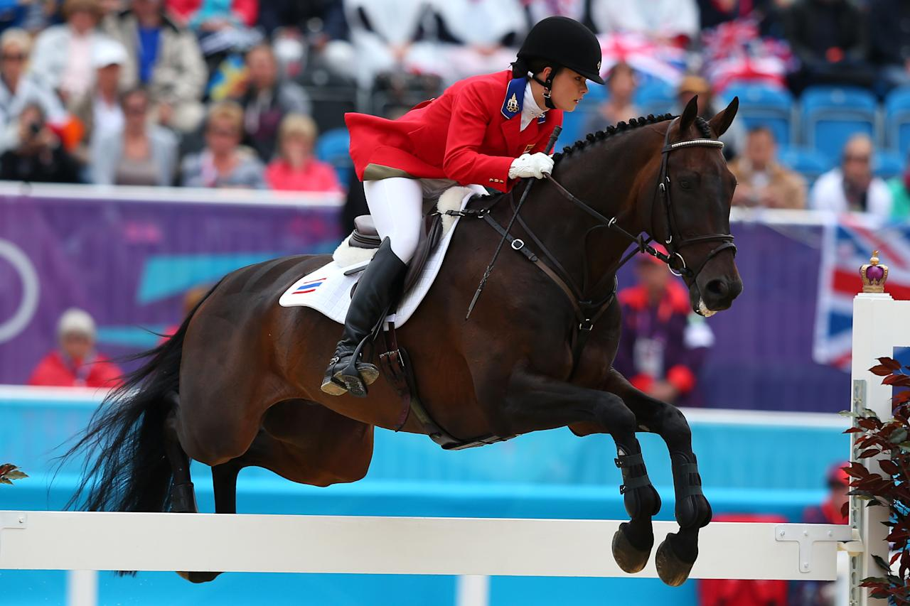 LONDON, ENGLAND - JULY 31: Nina Lamsam Ligon of Thailand riding Butts Leon in action in the Show Jumping Equestrian event on Day 4 of the London 2012 Olympic Games at Greenwich Park on July 31, 2012 in London, England.  (Photo by Alex Livesey/Getty Images)