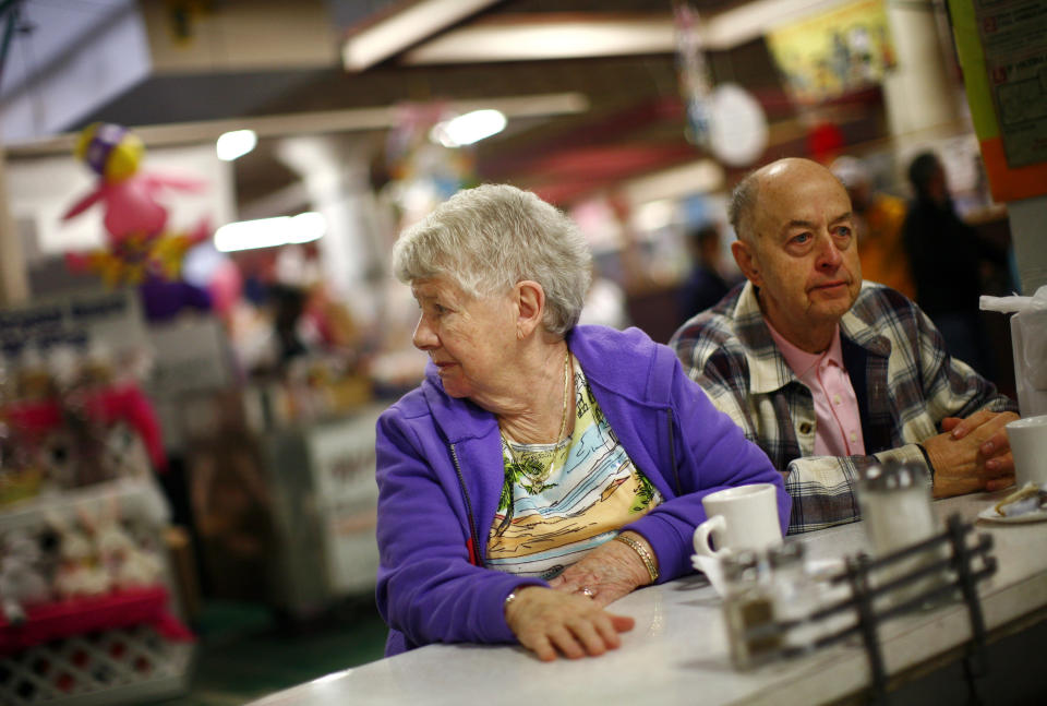 Nora and Anthony Szeluga sit at the counter of Perison's diner in the Broadway Market in Buffalo, New York. (REUTERS/Eric Thayer)