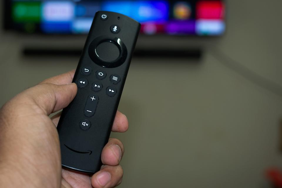 """All the different <a href=""""https://amzn.to/35Ygh1z"""" target=""""_blank"""" rel=""""noopener noreferrer"""">Fire TV Sticks</a> let you control what's happening on the screen with Alexa and stream Netflix, Prime Video,Disney+, HBO,Apple TV and YouTube all from your TV. Plus, all three have more movies and TV episodes to choose from than what's usually on cable. (Photo: Homesh Nasre via Getty Images)"""