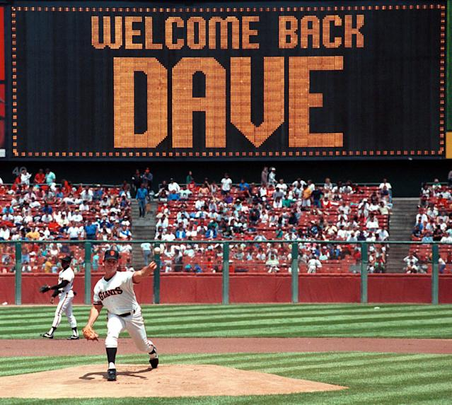 FILE - In this Aug. 10, 1989, file photo, San Francisco Giants pitcher Dave Dravecky warms up against the Cincinnati Reds at Candlestick Park in San Francisco. The game marked Dravecky's return to baseball after having a cancerous tumor removed from his pitching arm. The return of Dravecky was one of the most inspirational moments in the history of Candlestick Park. Candlestick Park, known for its bone-numbing winds, the Catch and the earthquake-rocked 1989 World Series is officially closing after more than a half century of hosting sporting and cultural events. In a bow to historical symmetry, the Stick's finale will be a performance Thursday by Paul McCartney, 48 years after the Beatles' last scheduled concert lit up the venue. (AP Photo/Eric Risberg, File)