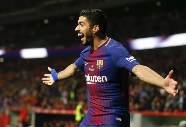 Barcelona's Luis Suarez celebrates after scoring against Sevilla during the Copa del Rey final soccer match between Barcelona and Sevilla at the Wanda Metropolitano stadium in Madrid, Spain, Saturday, April 21, 2018. (AP Photo/Francisco Seco)