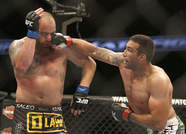 Fabricio Werdum, right, and Travis Browne fight during a UFC mixed martial arts bout on Saturday, April 19, 2014, in Orlando, Fla. Werdum won. (AP Photo/Reinhold Matay)