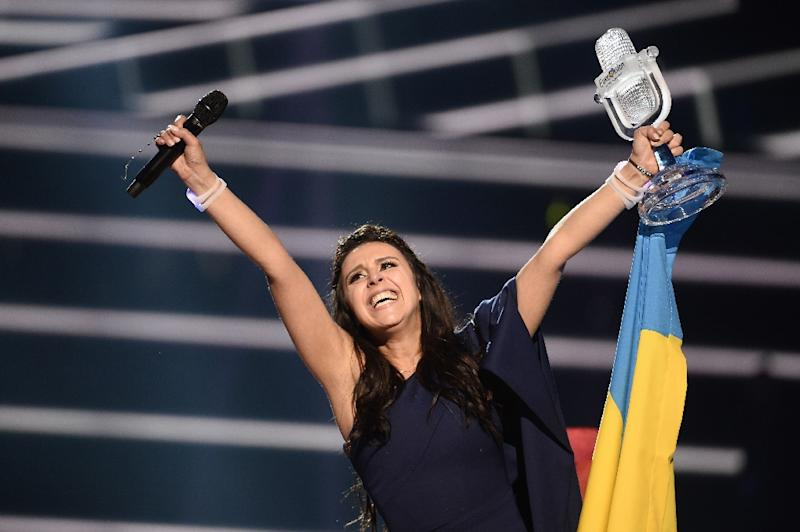Jamala celebrates with her country Ukraine after winning the Eurovision Song Contest in Stockholm on May 14, 2016 (AFP Photo/Maja Suslin/TT)