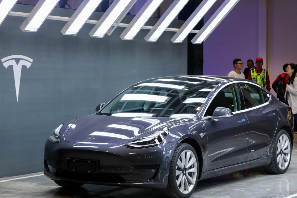 """A Tesla Model 3 car is displayed during the Tesla China-made Model 3 Delivery Ceremony in Shanghai. - Tesla CEO Elon Musk presented the first batch of made-in-China cars to ordinary buyers on January 7, 2020 in a milestone for the company's new Shanghai """"giga-factory"""", but which comes as sales decelerate in the world's largest electric-vehicle market. (Photo by STR / AFP) / China OUT (Photo by STR/AFP via Getty Images)"""