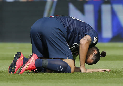 FILE - In this Aug.16, 2014 file photo, Paris Saint Germain's Swedish Zlatan Ibrahimovic, kneels on the pitch after being injured, during a French League One soccer match, PSG against Bastia, at the Parc des Princes stadium, in Paris. Instead of catching up with the Premier League or the Bundesliga, a growing catalog of signs indicates that French Ligue 1 clubs _ with the exception of Qatari-owned Paris Saint-Germain _ are slipping further behind rivals in England, Germany, Spain and Italy. Russia, sinking hundreds of billions of rubles of public and private money into the 2018 World Cup and its football clubs, is also now snapping at France's heels. Armed with an awesome collection of players, owners with seemingly bottomless pockets, and by far the biggest revenues and crowds of Ligue 1, PSG has quickly become a European force. But it could be a long, long time _ perhaps never _ before the likes of Marseille, Saint-Etienne, Monaco or Reims play another European Cup final. (AP Photo
