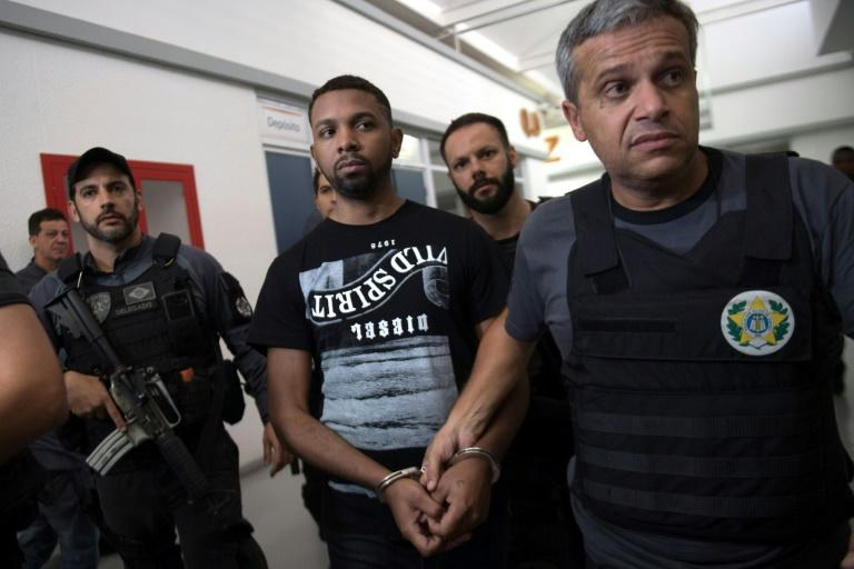 "Alleged Rocinha favela drug boss Rogerio Avelino da Silva, nicknamed ""Rogerio 157,"" is escorted by Brazilian Civil Police at the police headquarters, after being arrested in Rio de Janeiro"